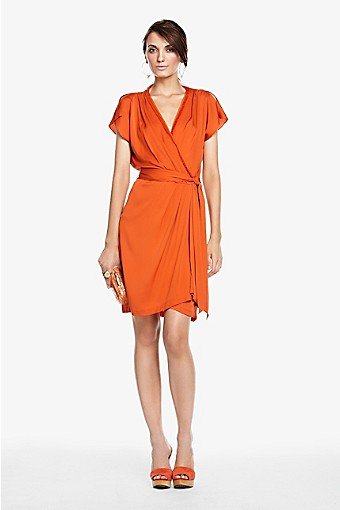 f081edb716ac Orange is a super hot color heading into Spring. Love Love this signature  georgette wrap dress by Diane Von Furstenberg. A great back drop for  amazing ...